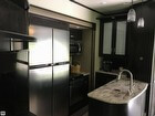 Kitchen Sink, Counters, Fridge / Freezer And Convection Microwave Oven.