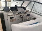 GPS / Fishfinder, Radar, Trim Tab Controls, Accessory Switches, Compass