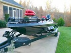 Champion Bass Boat On Trailer At Home