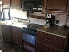 Double Kitchen Sink, Microwave/convection Oven, Oven, Stove, Cabinets, Counter