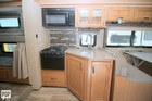 Microwave Oven, Stove, Sink, Cabinets, Dinette, Bunk Beds