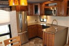 Island Kitchen With A Full Size Refrigerator And Freezer With Ice Maker, Stove, Oven & Microwave
