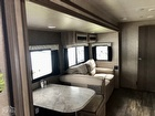 Booth dinette, TV facing couch