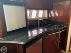 There is a Large LCD TV that can be lowered from the Ceiling! over the galley
